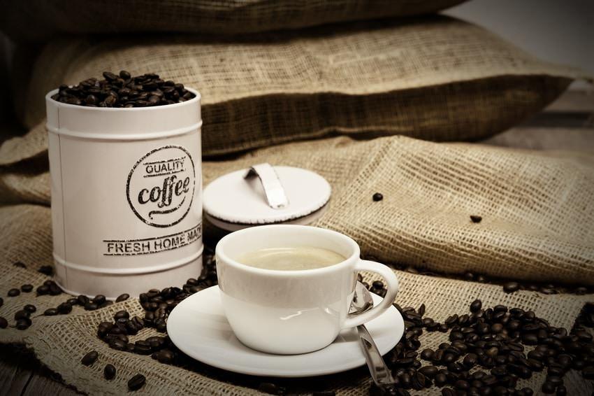 Coffee Beans And Mug On Table